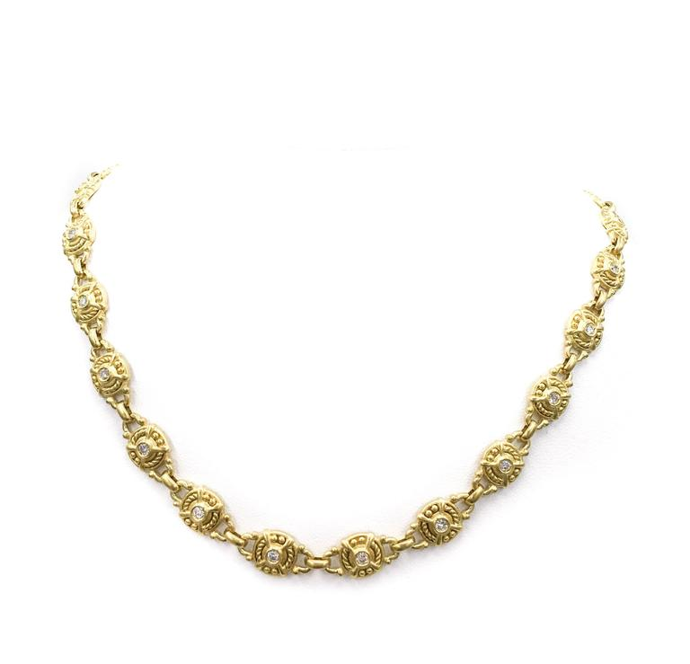 Judith Ripka's timeless design is instantly recognizable! This fabulous 18kt yellow gold finely detailed choker can easily be worn from daytime to night. Has the perfect finishing touch with 24 round white diamonds weighing 1.50 carats total.