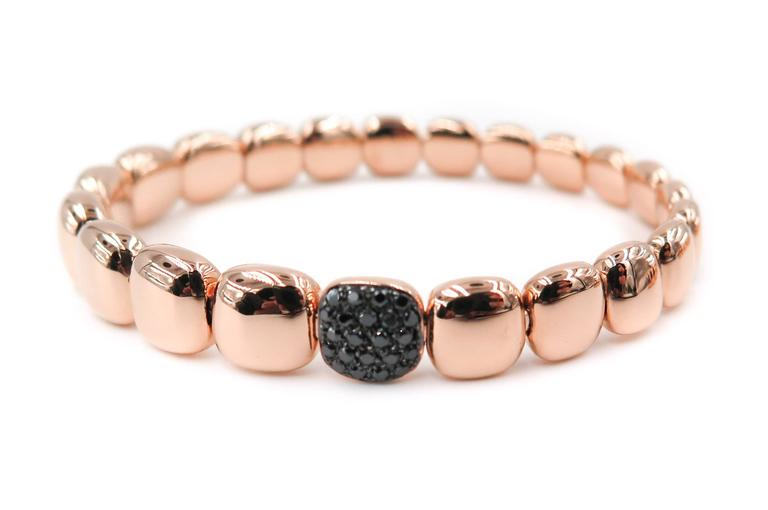 This graceful 18k rose gold cushion shaped beads bracelet, handcrafted in Italy featuring 20 sparkling round black diamonds set in the center bead. Bracelet is constructed with a unique stainless steel coil mechanism that allows the bracelet to