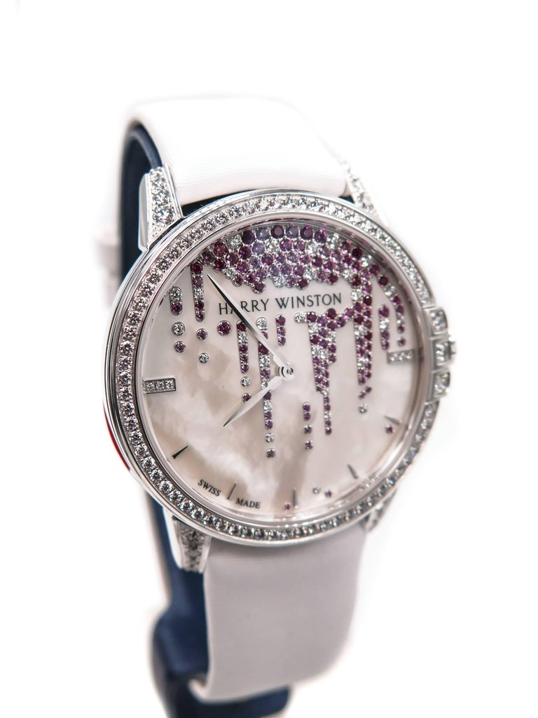 Effortlessly elegant and timelessly classical, this Midnight timepiece is exquisite! Midnight Diamond Stalactites 36mm in 18k white gold.  Mechanical automatic winding, 28 jewels, 28,800 vibrations per hour.  Open sapphire crystal case back. The