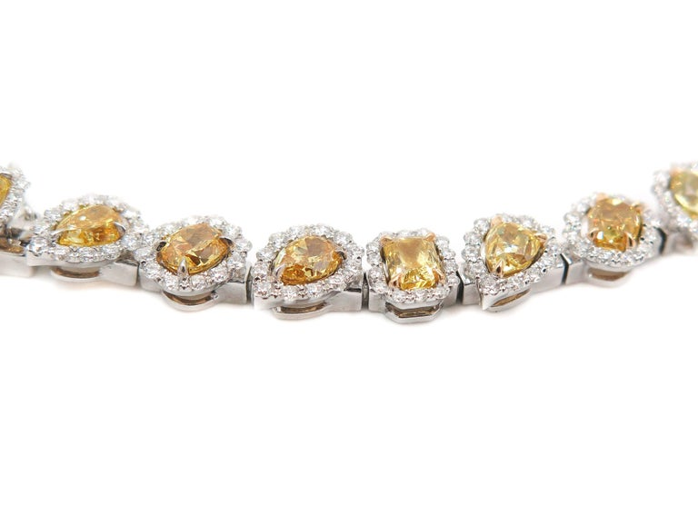 Halo Fancy Yellow Diamond White Gold Bracelet In As new Condition For Sale In Greenwich, CT