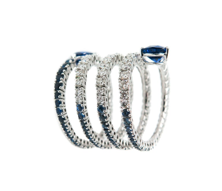 Artist Sapphire and Diamond Spiral White Gold Ring For Sale