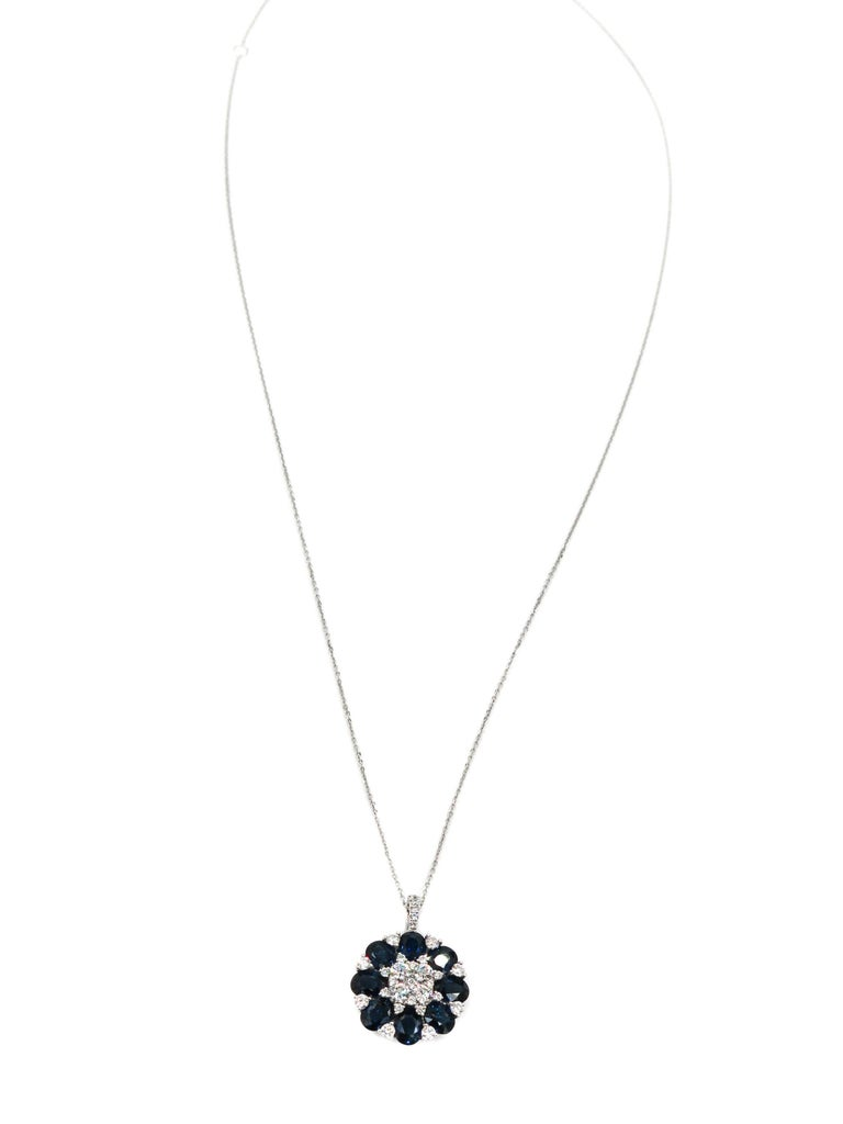 When words are not enough... colors and shapes can speak for themselves.  Eight oval cut blue sapphires, enriched by 31 round brilliant cut diamonds bloom into this beautiful pendant.   Creatively crafted in 18 karat white gold, with 3.64 carats of