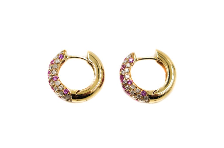 To the fashion connoisseur, having a beautifully handmade piece of jewelry by an Italian designer is owning a very special piece of jewelry. This pair of huggies showcases the workmanship being featured in a fine pave work.  This confetti of colors