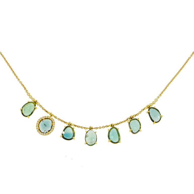 The garden party motif isn't going anywhere... In line with the pastel and floral jewelry trends, light and airy color schemes with plenty of diamonds are sure to please everyone. Just like this unique Blue Tourmaline drops Necklace designed and