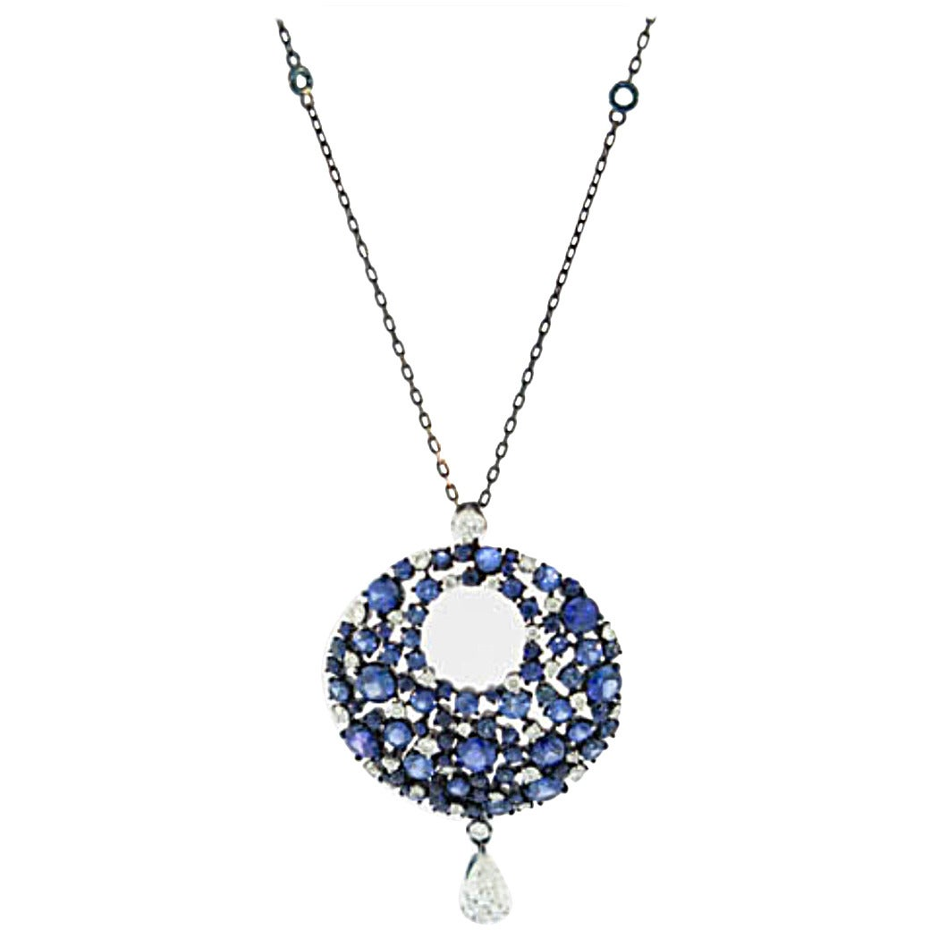 Mariani Sapphire Diamond Gold Eclipse Pendant For Sale