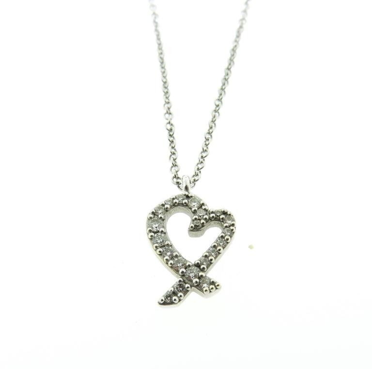 f51e9eced Paloma Picasso Diamond Gold Loving Heart Pendant For Sale. A timeless  design by Paloma Picasso. This beautiful necklace from Tiffany & Co. Loving