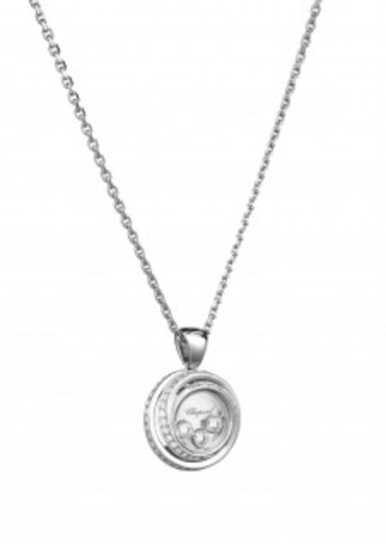 Stylish... this Happy Emotion Pendant set with diamonds in 18 karat white gold, the spiral of precious metal becomes a radiant nest of light, encircling 3 moving diamonds between their sapphire crystals as they perform the most beautiful and