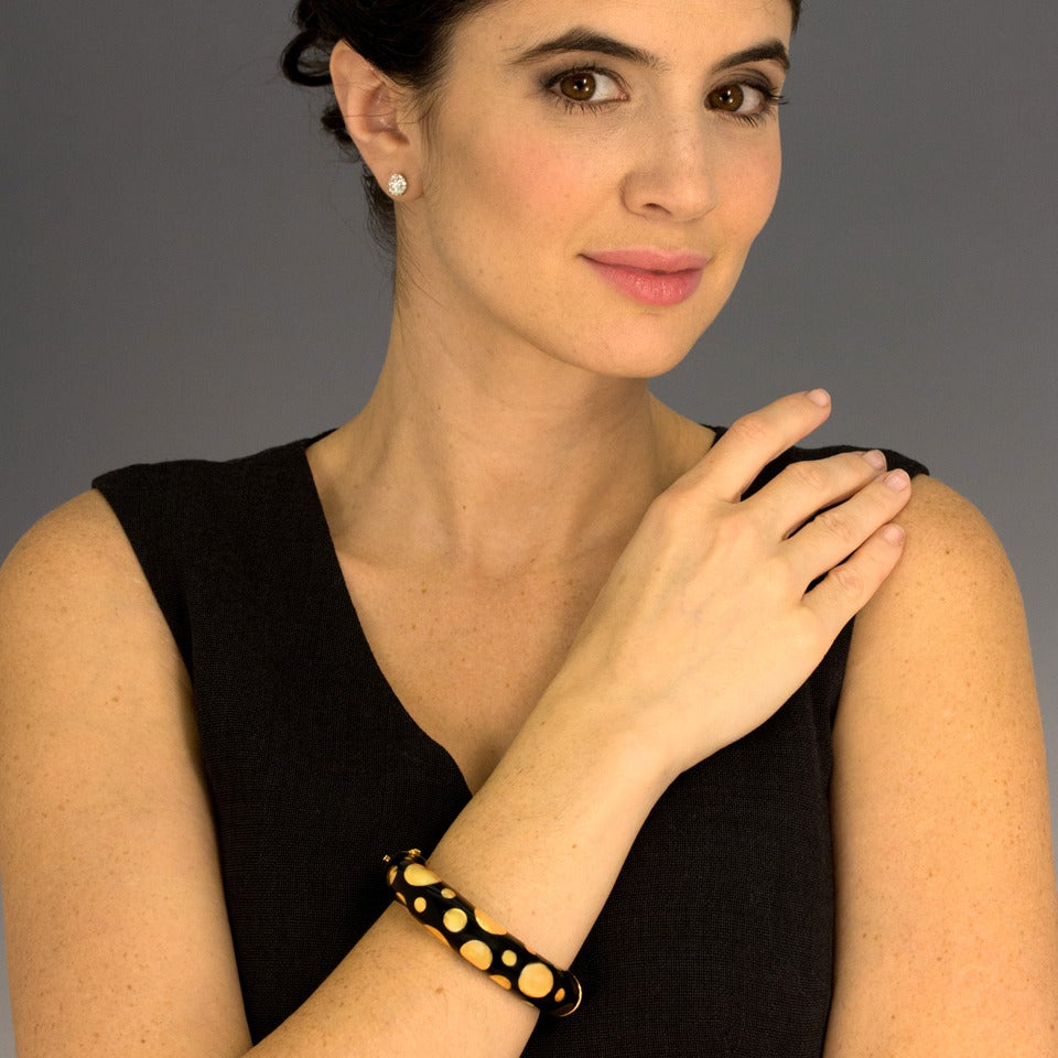 Circa 1980s, 18k, Italy.  Covered with polka dots, Pop Art meets high fashion in this expressive, playfully chic bracelet.  The black and gold color scheme is elegant and the subject matter visually irreverent. Or perhaps I should just say it is a