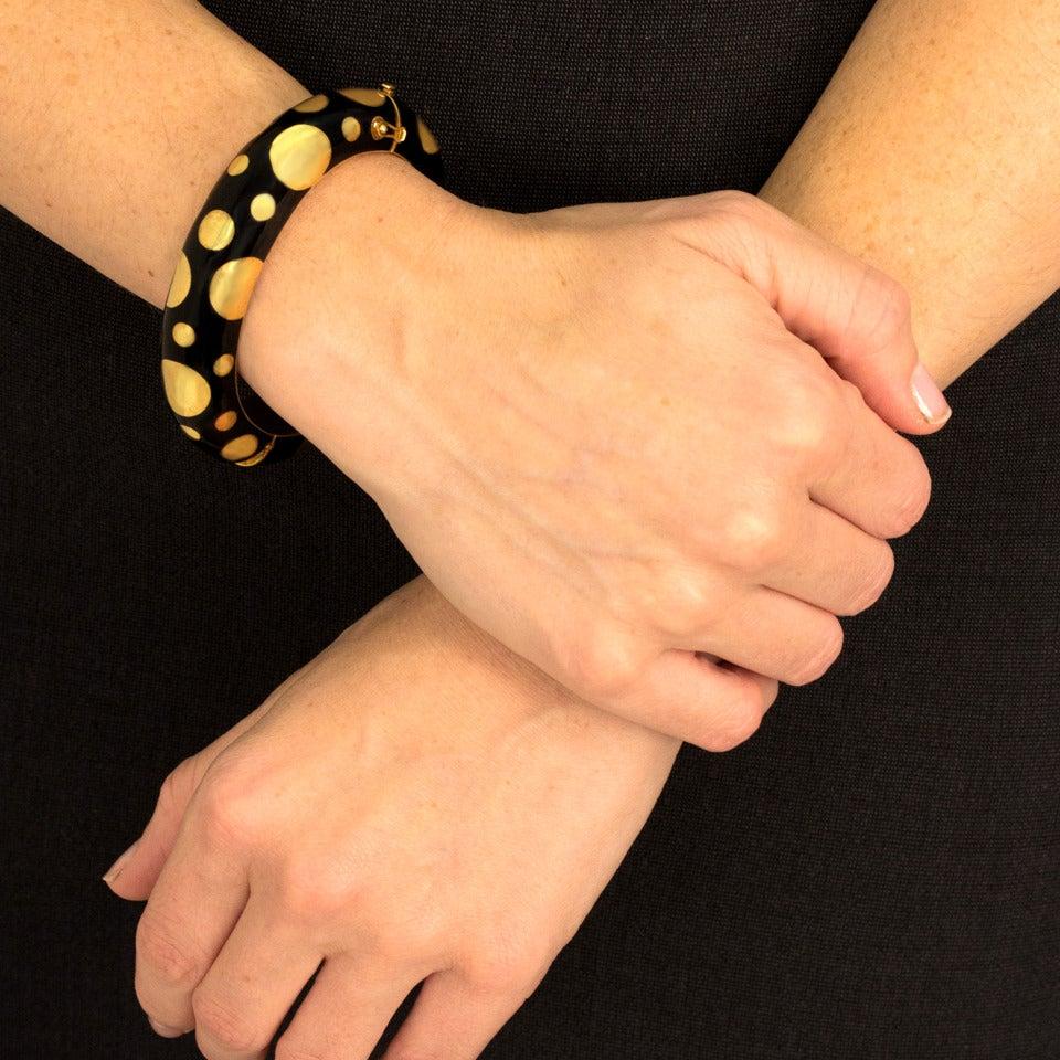 1960s Black Enamel Gold Polka Dot Bangle Bracelet In Excellent Condition For Sale In Litchfield, CT