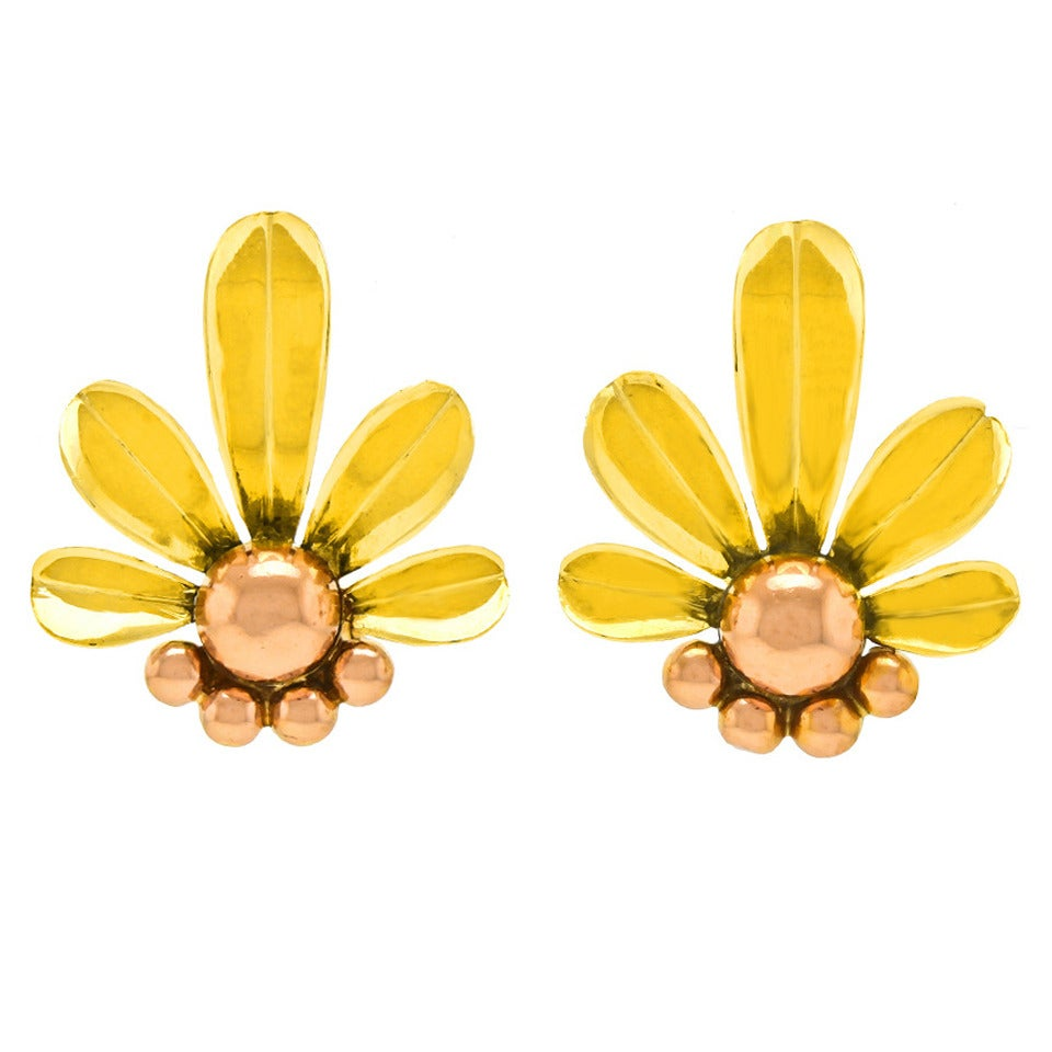 Circa 1930s, 14k, Austria. Stylishly au courant, these Art Deco flower earrings have a timeless quality that pairs well with any look. They are pop art before pop art existed. Beautifully made in fourteen karat yellow and rose gold, they are in