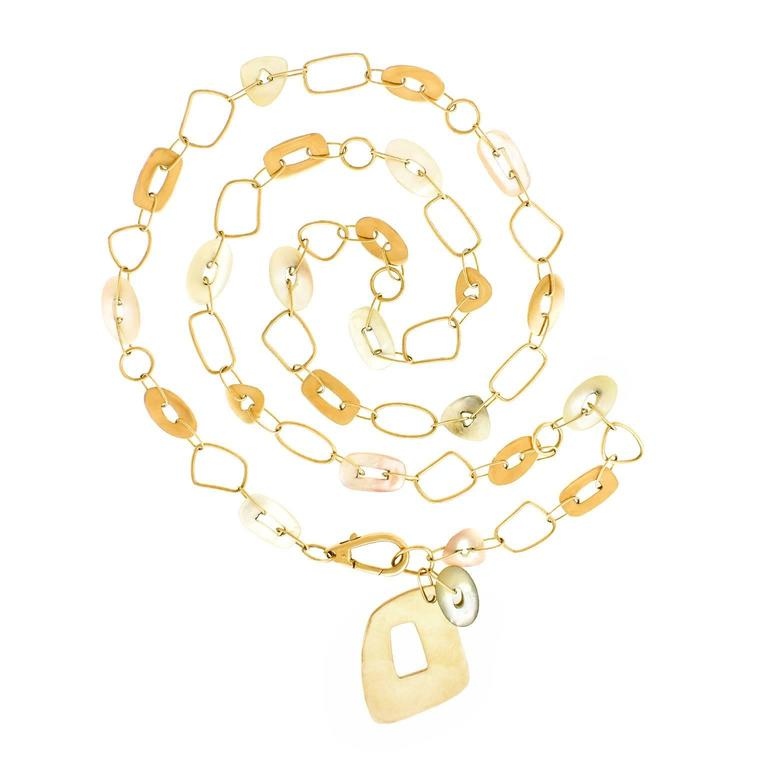 """Contemporary, 18k, by Mattioli, Italy. This stylishly long necklace melds modern organo-chic with seventies groove. Easy breezy, it features amorphous rose gold links punctuated by mother of pearl elements. From Mattioli's iconic """"Puzzle"""" line, the"""