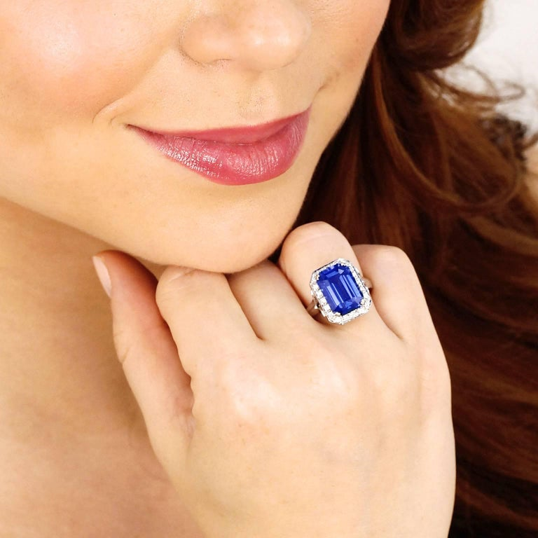 Circa 1980s, 18k, American. This ring is all about the lush 7.0 carat emerald cut tanzanite. Its brilliant deep lavender-blue color and fine clarity are sublime. Additionally set with .48 carats of superb white accent diamonds, this ring features