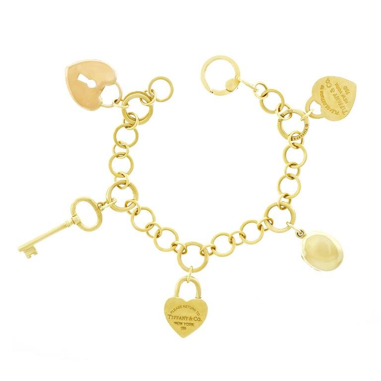 Tiffany & Co. Lock and Key Gold Charm Bracelet