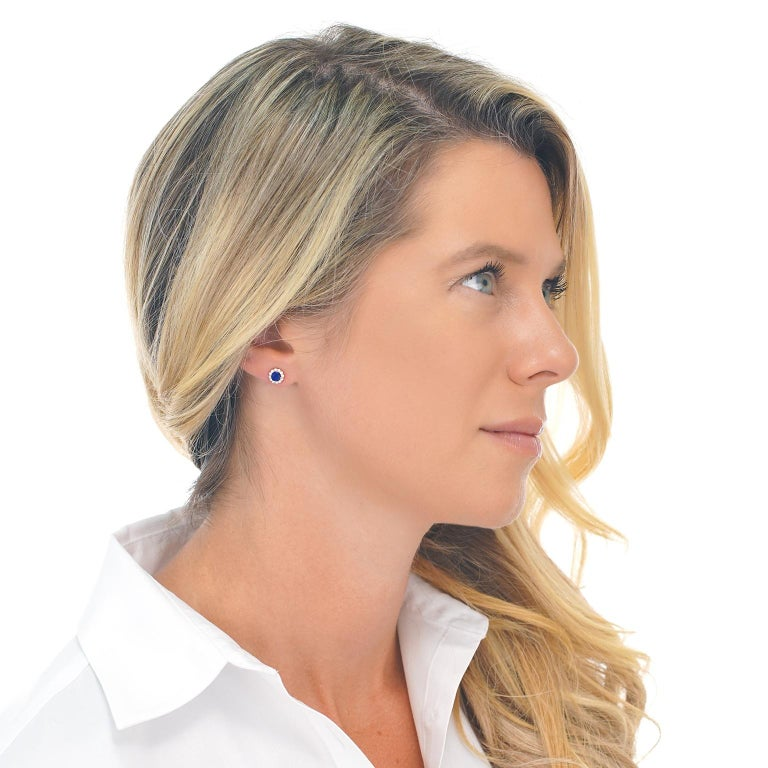Circa 2000's, 14k, American.  These earrings feature bright blue sapphires surrounded by brilliant diamonds set in rich rose gold. The perfect size for everyday wear, they effortlessly go with everything. Finely fabricated, this pair of earrings are