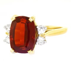 Garnet and Diamond Set Gold and Platinum Ring