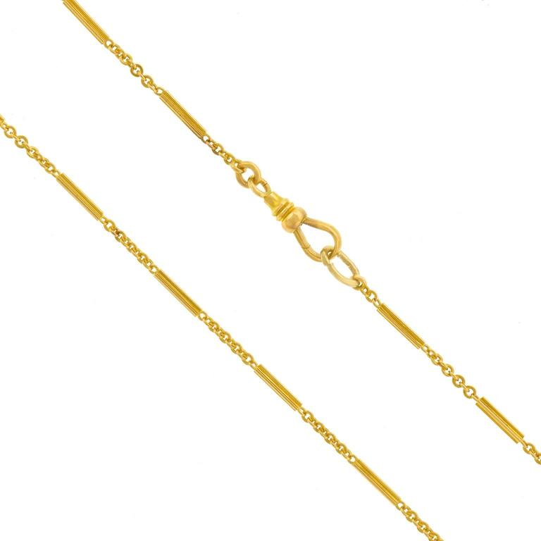 Circa 1890s, 14k, American. This fourteen-karat gold necklace is a beautiful example of nineteenth-century jewelry. Stylish elements are interspersed with links, giving this handmade piece a sophisticated and unique look. It can be worn long,