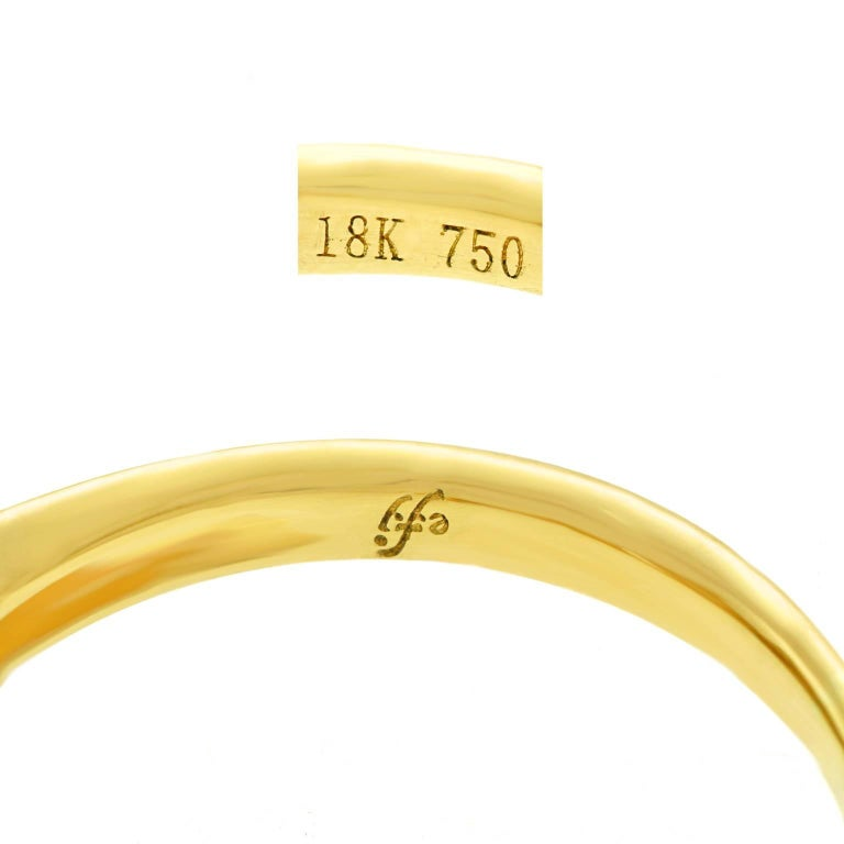 Circa 2000s, 18k, American.  Set with a brilliant white 1.14 carat center stone (I color and VS1 clarity, GIA report), surrounded by .75 carats total weight of fine white accent stones, this eighteen-karat yellow gold ring has delicate details,