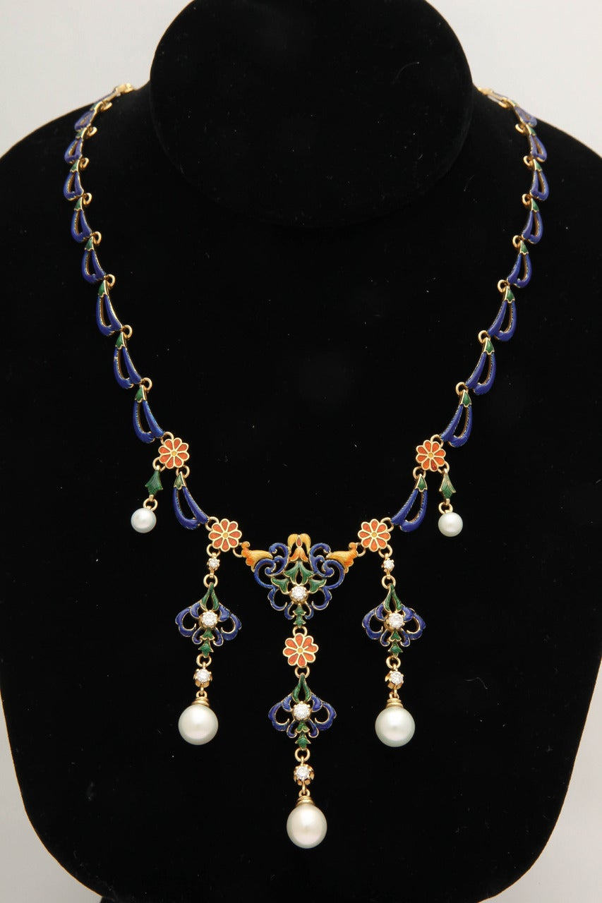 A grand necklace in the Byzantine style, of openwork scroll, floral and foliate motifs in multicolored enamel, enhanced with diamonds and drop pearls, the blue enamel backchain of wave design, in 18k gold.