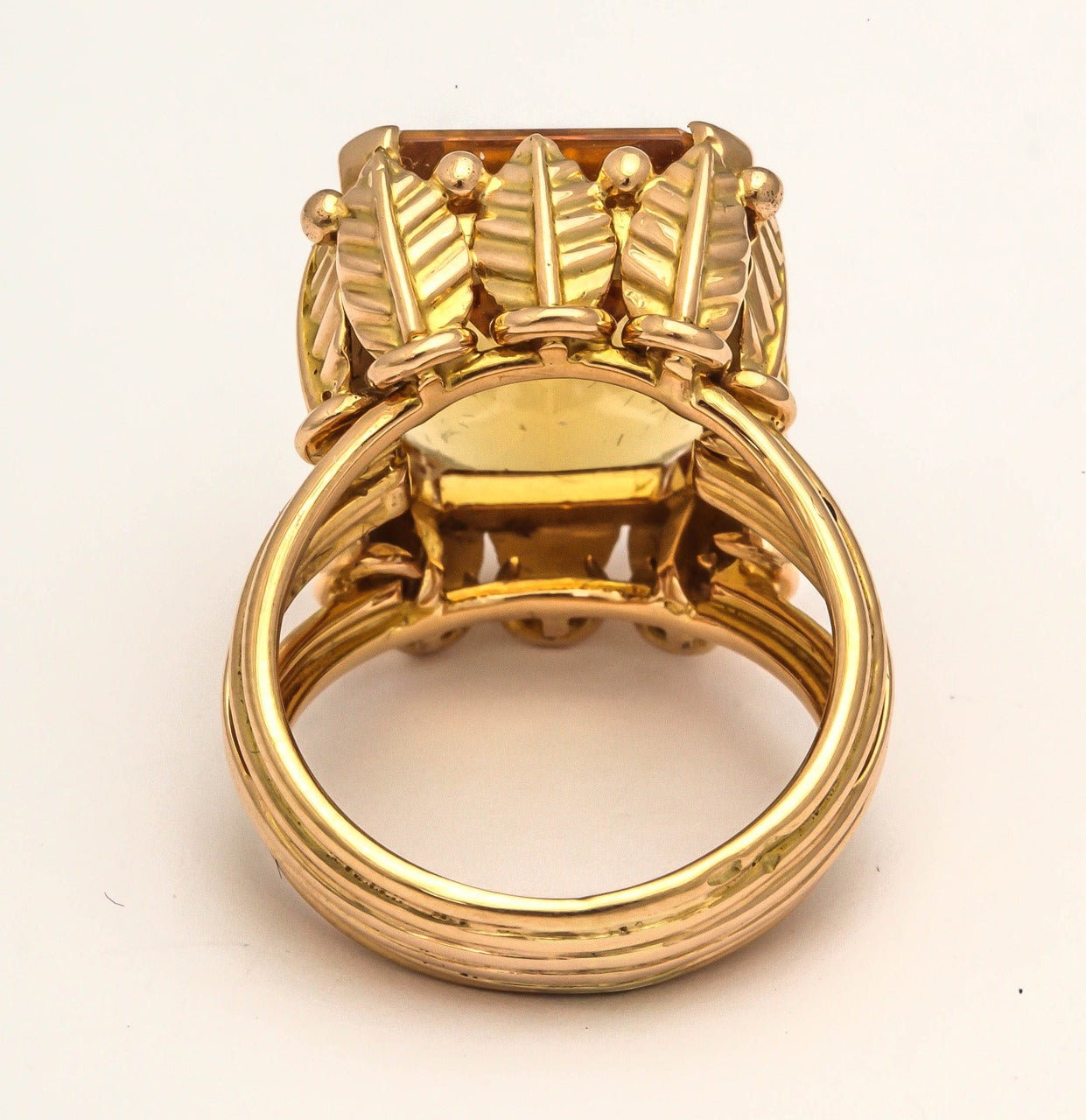 Elegant 1970s French citrine statement ring, the 18k gold mount designed as a row of wheat sheaves, ancient symbol of prosperity, set with a rectangular-cut citrine with canted corners.  Paris, France, hallmarked.  Size 6
