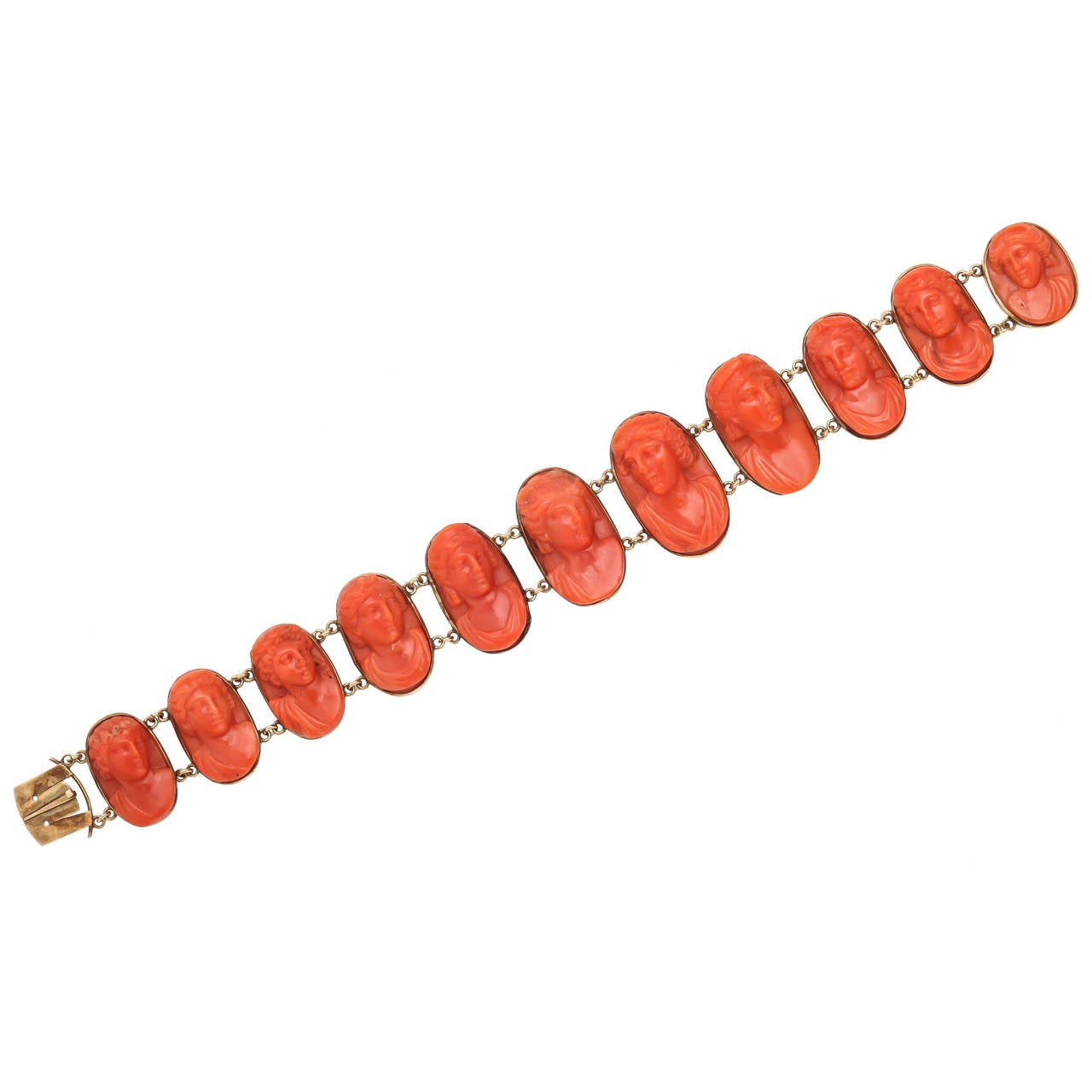 Designed as a graduated line of oval coral cameos carved in high relief, each link framed in gold and connected by small gold chains.  Circa 1870, unmarked.  7 in. (17.8 cm.) long; largest cameo 7/8 in. (2.2 cm.) long, including mount.