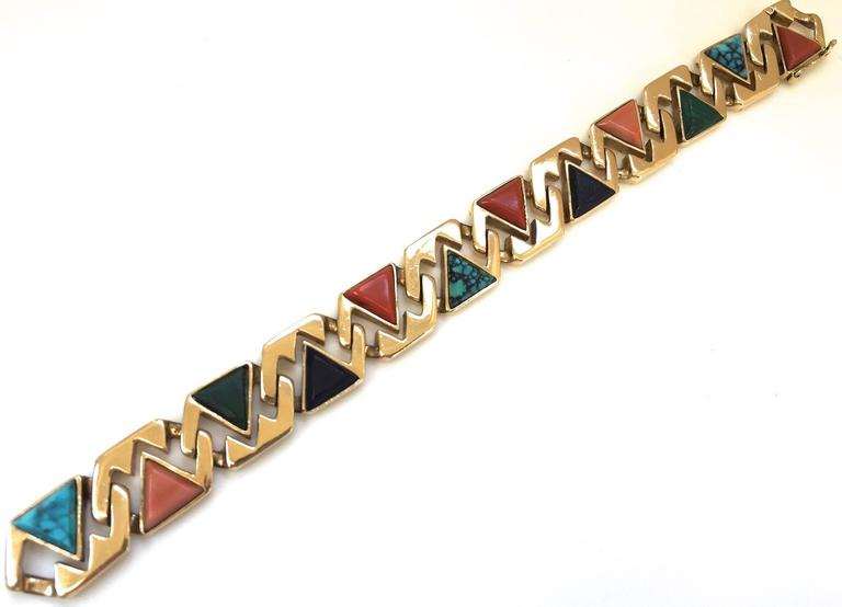 """A chic reversible link gold and multigem bracelet. The 14k  1/2"""" x 7 1/4"""" bracelet made up of geometric links embellished with relief carved pyramidal stones, including, turquoise, coral, malachite and lapis lazuli. An interesting and unusual"""