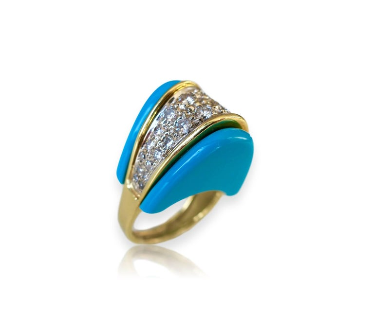 "Gold and diamond cocktail ring. The 1 1/2 x 3/4"" bright sky-blue and 18k yellow gold  bullet-shaped ring with one carat of round white diamonds. Showy and fun. *Turquoise has not been tested for natural vs lab created. Ring sits 1/2"" high."