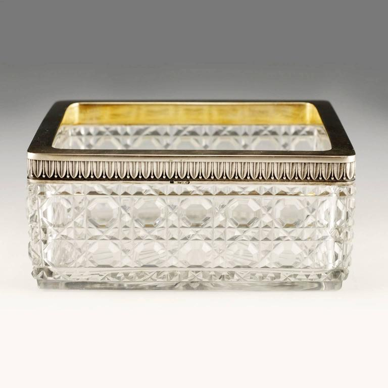 A Russian silver-mounted rectangular cut lead glass serving dish, Petr Fariseev, Moscow, circa 1908-1917. In Neoclassical taste, the rectangular glass dish, almost cetainly from the Bakhmetev Glassworks, cut in a combination hobnail-cane pattern,