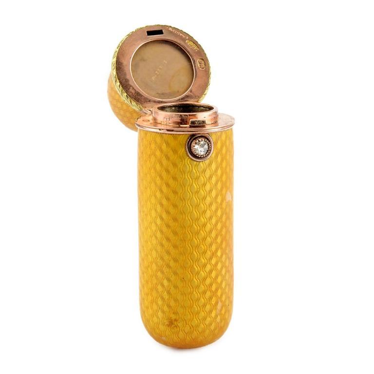 A Fabergé diamond-set two-color gold and guilloché enamel perrfume or scent bottle, workmaster Michael Perchin, Saint Petersburg, circa 1899-1903, original scratched Fabergé inventory number 2820. Capsule form, the surface enameled translucent