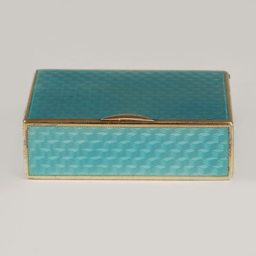 A Fabergé gilded silver and guilloché enamel match box (vesta case), Moscow, 1899-1908, Fabergé scratched inventory number 28271. Of rectangular form, the exterior enameled entirely with translucent teal blue enamel over a wavy engine-turned ground,