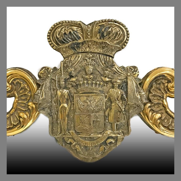 An important antique Polish gilded silver table mirror for Count Ivan Paskevich-Erivanskii, Karol Filip Malcz, Warsaw, 1828-1831. The shaped mirror framed with a gilded silver mount chased with scrolls and shells, surmounted by the new coat-of-arms