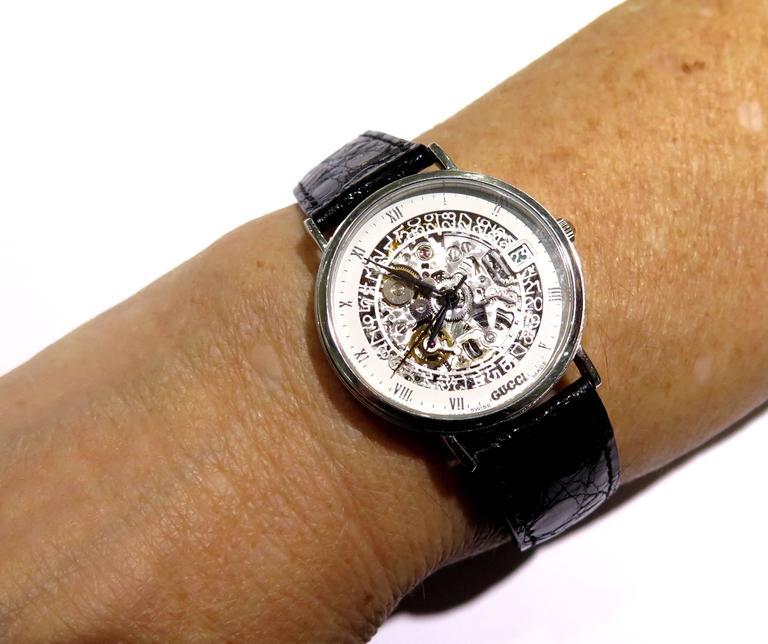 Gucci Platinum White Enamel Border Skeleton Wristwatch At