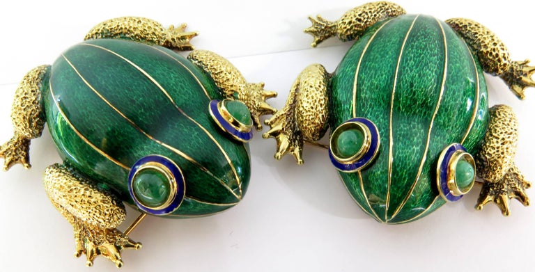 This pair of frogs are totally different from the ones most are used to seeing. The unique oversize and shape of these 2 frog pins make them extremely desireable. They are set in 18k yellow gold. They look so good when you change their positions to