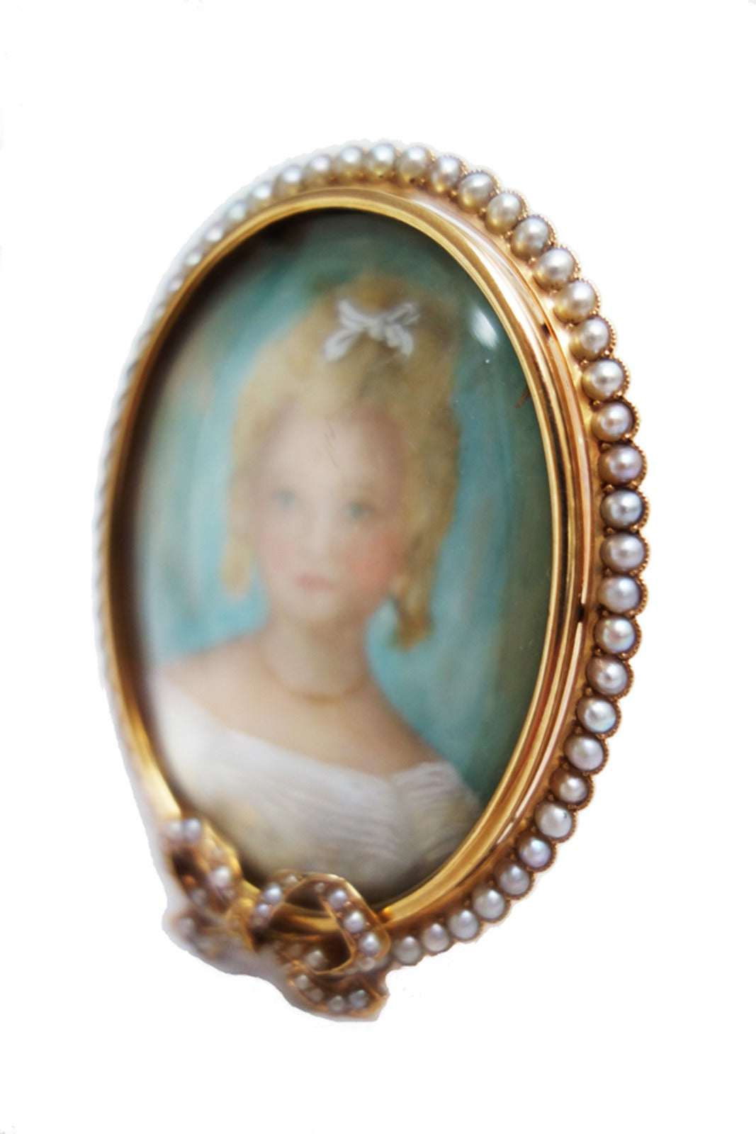 Antique 14K Rose Gold and Pearl Portrait Miniature Picture Frame. Watercolor portrait miniature of a lovely young woman. Circa 1890-1900 Executed in soft blue-greens, creams, whites and browns. Frame completely encircled by natural seed pearls.