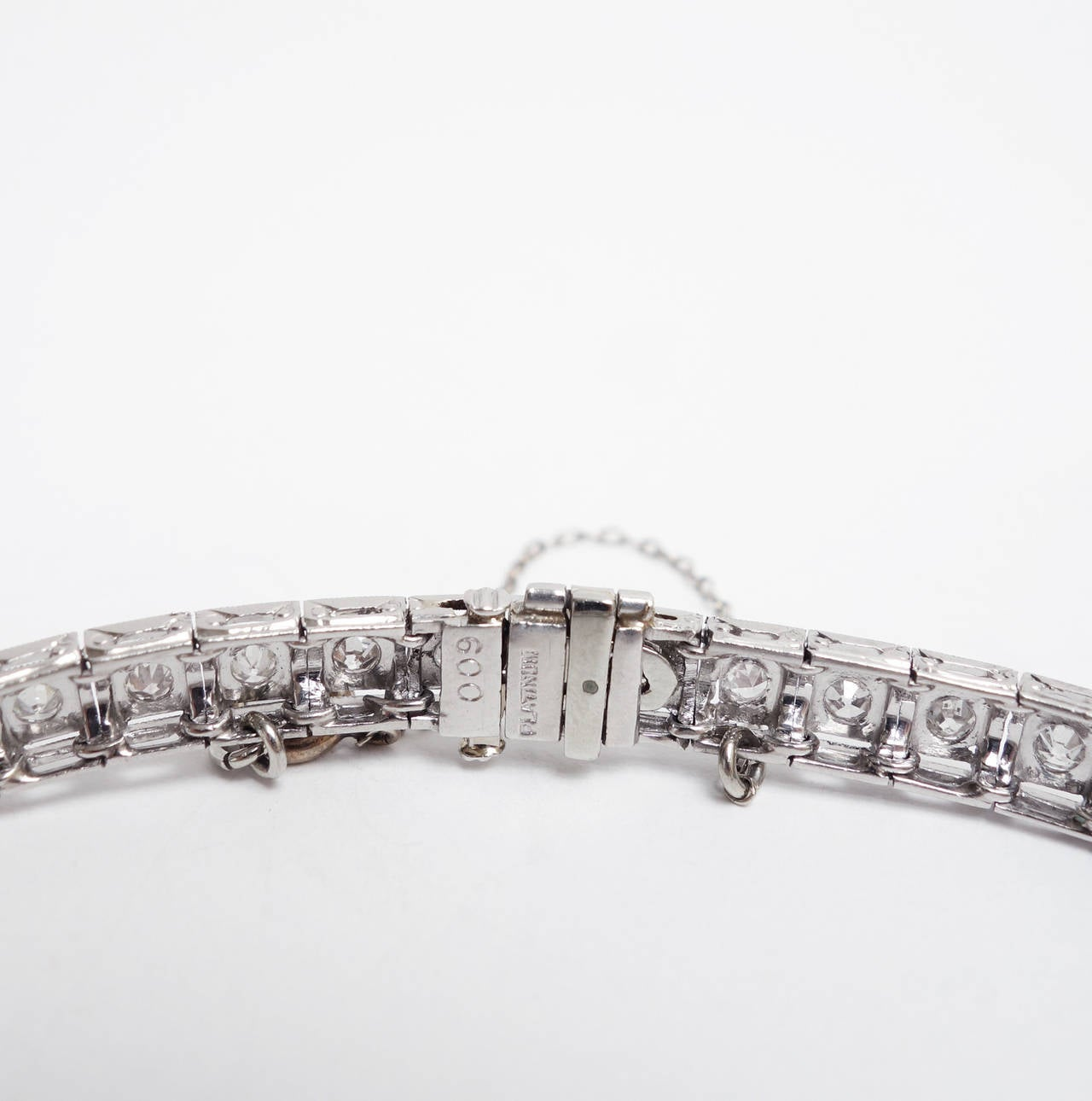Elegant Art Deco Platinum Diamond and Sapphire bracelet. The diamond center piece features a marquise cut diamond, weighing approx. 0.20 ct, set within a bezel of french cut blue Sapphires. The bracelet is completed by 27 in-line diamond set box