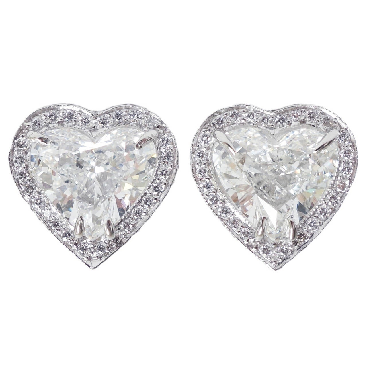 heart shape covered cut with diamond in a engagement ring white shank halo gold double pave
