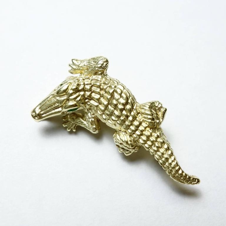 14K yellow gold alligator brooch with emerald eyes. Amazing details and three dimensional effect.  Measurement: W 32mm x H 17mm Weight: 6.5 grams