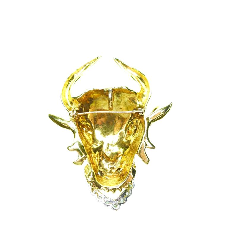 Custom made hand crafted 1960s 14K yellow and white gold large bull's head brooch/pendant with diamonds. 11 round brilliant cut diamonds, approximate total weight of 0.25ct. Measurements: H 60mm x W 49mm x D 14mm Weight: 38.2 grams