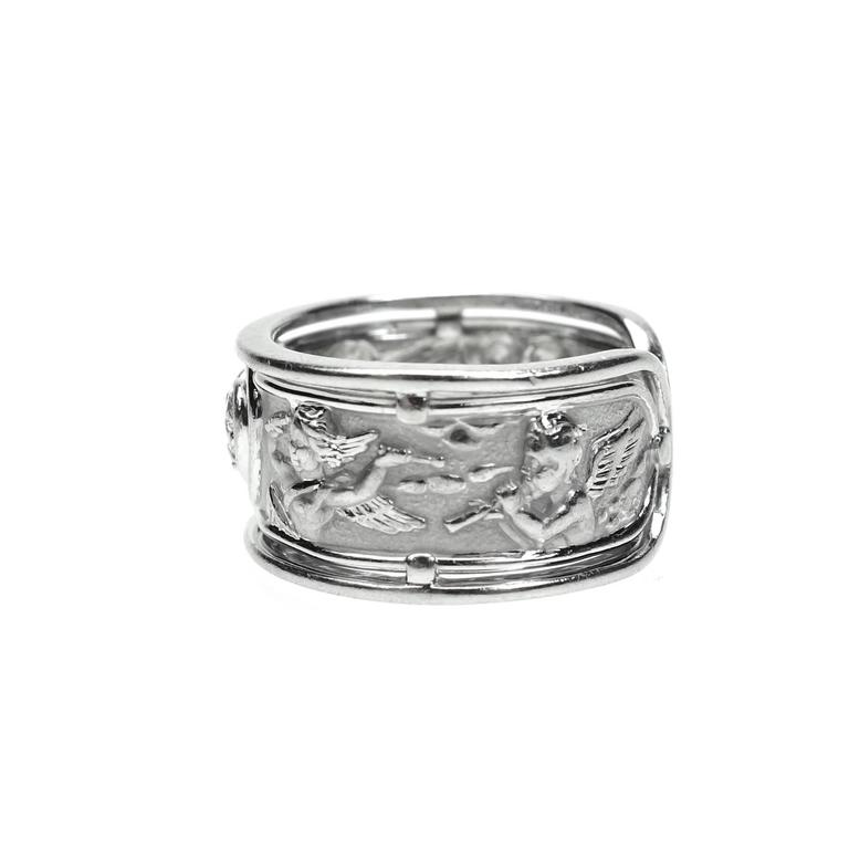 Carrera y Carrera RONDA Angels 18K white gold  wide band with diamonds. Style # 260171 Motif: Heart & Angels Band Size: 7 (US) Width: 15 mm Weight 6.3 grams Signed, CyC(logo) Stamped, 305593 750 Condition: This ring is in very good pre-owned