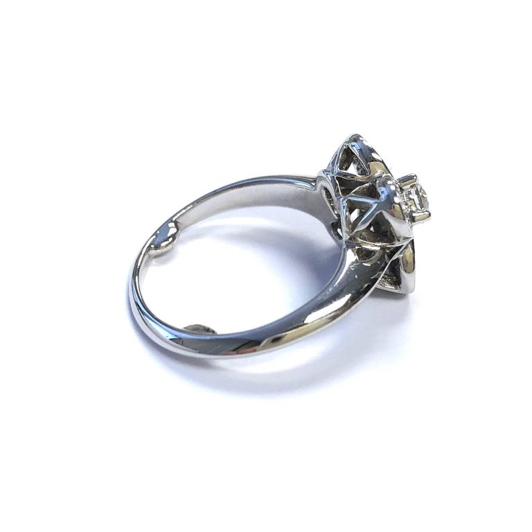 Van Cleefs & Arpels 18K white gold ring from the timeless Trefle collection.   Featuring pave-set round diamond petals encircling a round brilliant cut diamond at center. Approximate total diamond weight: 0.75ct.  Measurements: 0.43