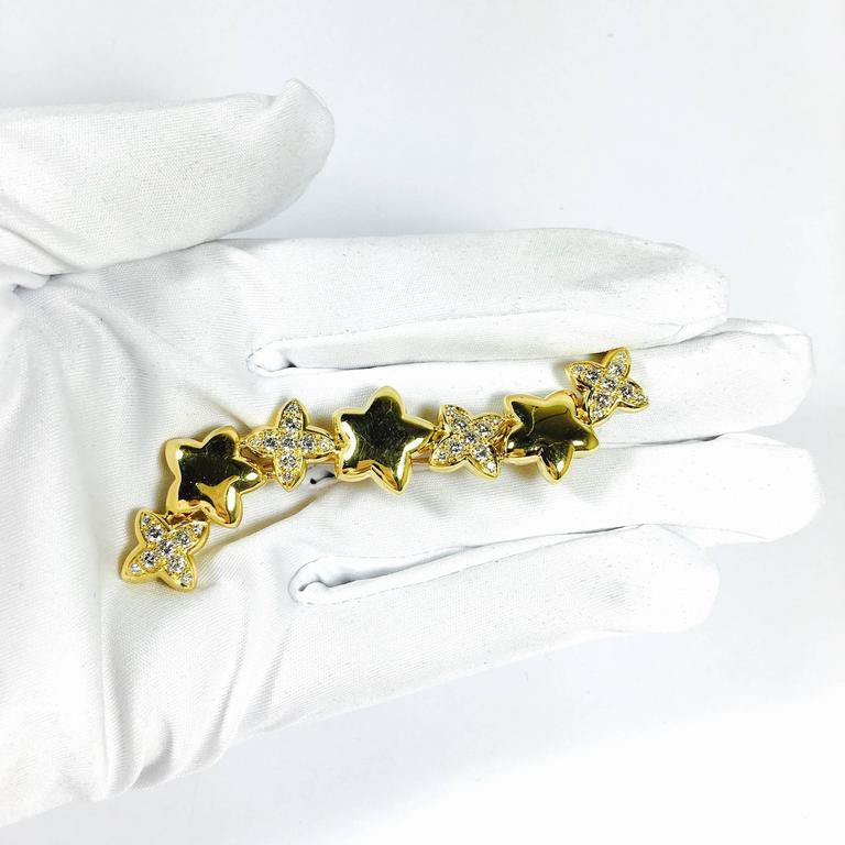 Van Cleef & Arpels Stars Diamond Gold Earrings and Brooch For Sale 4