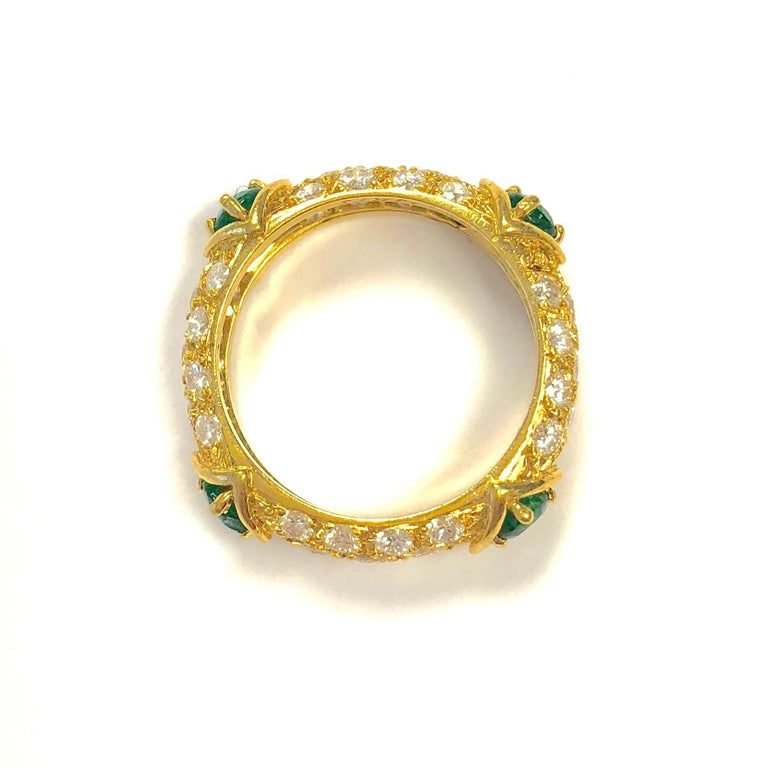 18K yellow gold pave' set diamond band with four emeralds.