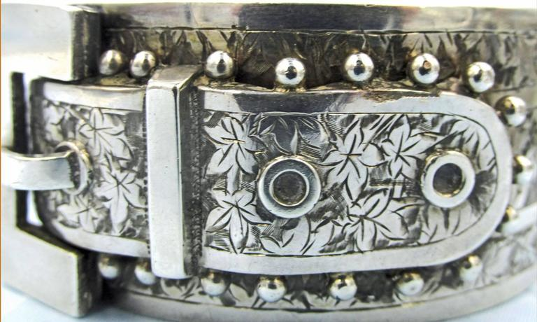 Bold and dramatic Victorian buckle bracelet engraved with ivy leaves and decorated with beads. Lovely to wear alone or with other bangles, either silver or gold. This piece measures 1 1/4