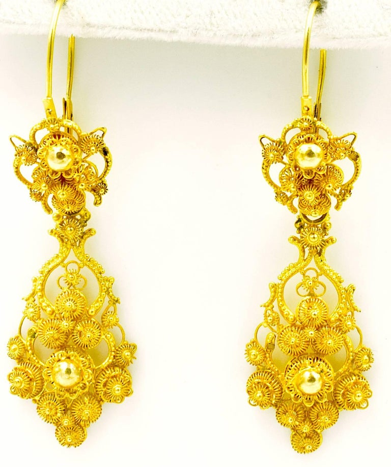 Fabulous cannetille 18K gold earrings made in Amsterdam by Gerdes & Pisort in the 1840's. Cannetille jewelry was based on a style of fabric embroidery that was adapted to precious metal. It is made with fine, twisted wire or thin sheets of gold.