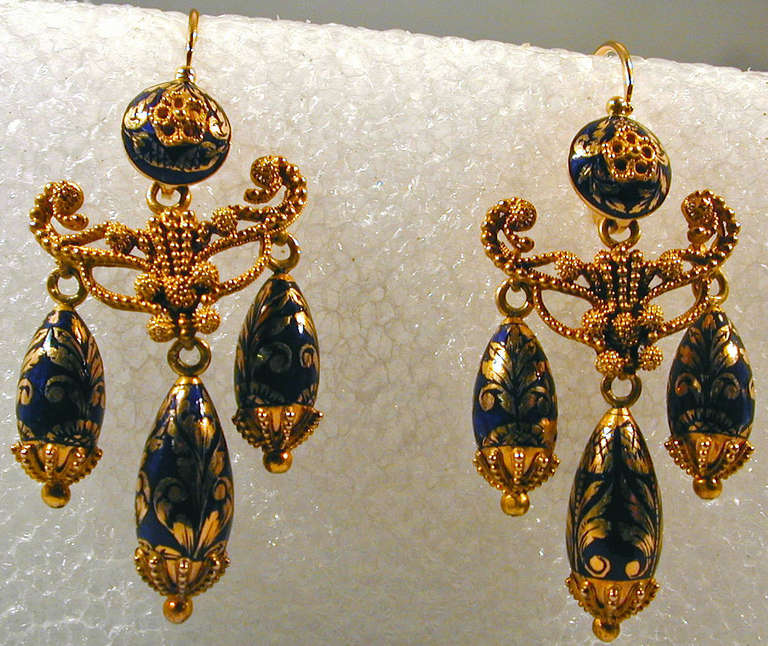 Elegant Georgian girandole earrings in 15K gold and cobalt enamel. The gold work is an elaborate Etruscan design decorated with tiny balls. The earrings measure  1 3/4