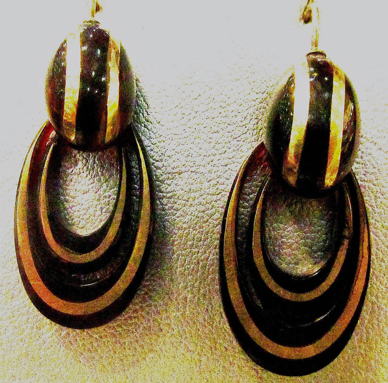 Bold Victorian pique hoop earrings of tortoiseshell inlaid with gold. The technique for making pique was brought to England by the Huguenots when they were expelled from France in the late 17th Century. Pique jewelry blossomed in the late 1800's.