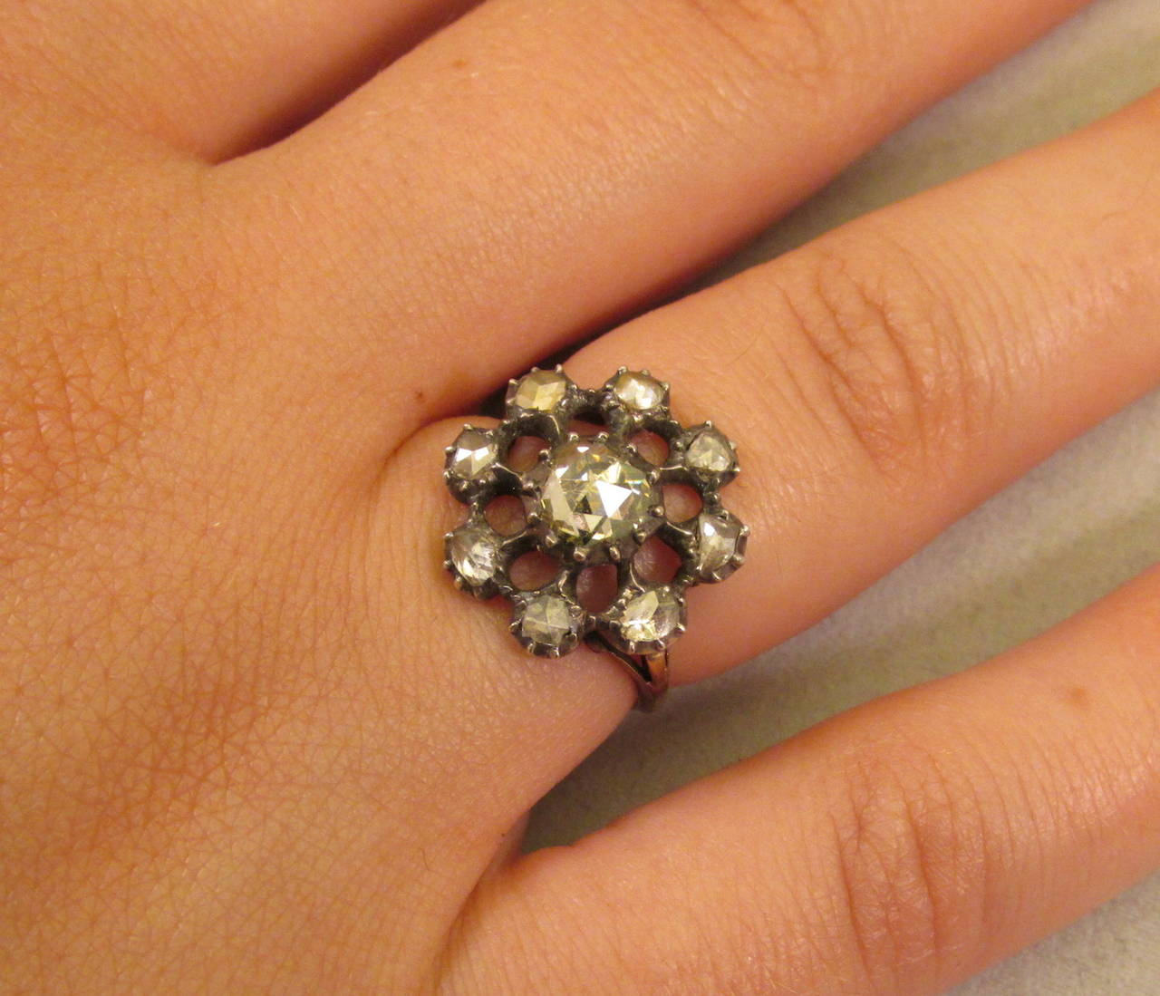 Dramatic Georgian rose diamond cluster ring set in silver with an 18K gold band. The center stone is a large Dutch crown rose diamond. The cluster ring head is almost .75 inches in diameter, large and imposing. The ring is size 6 1/4 and can be