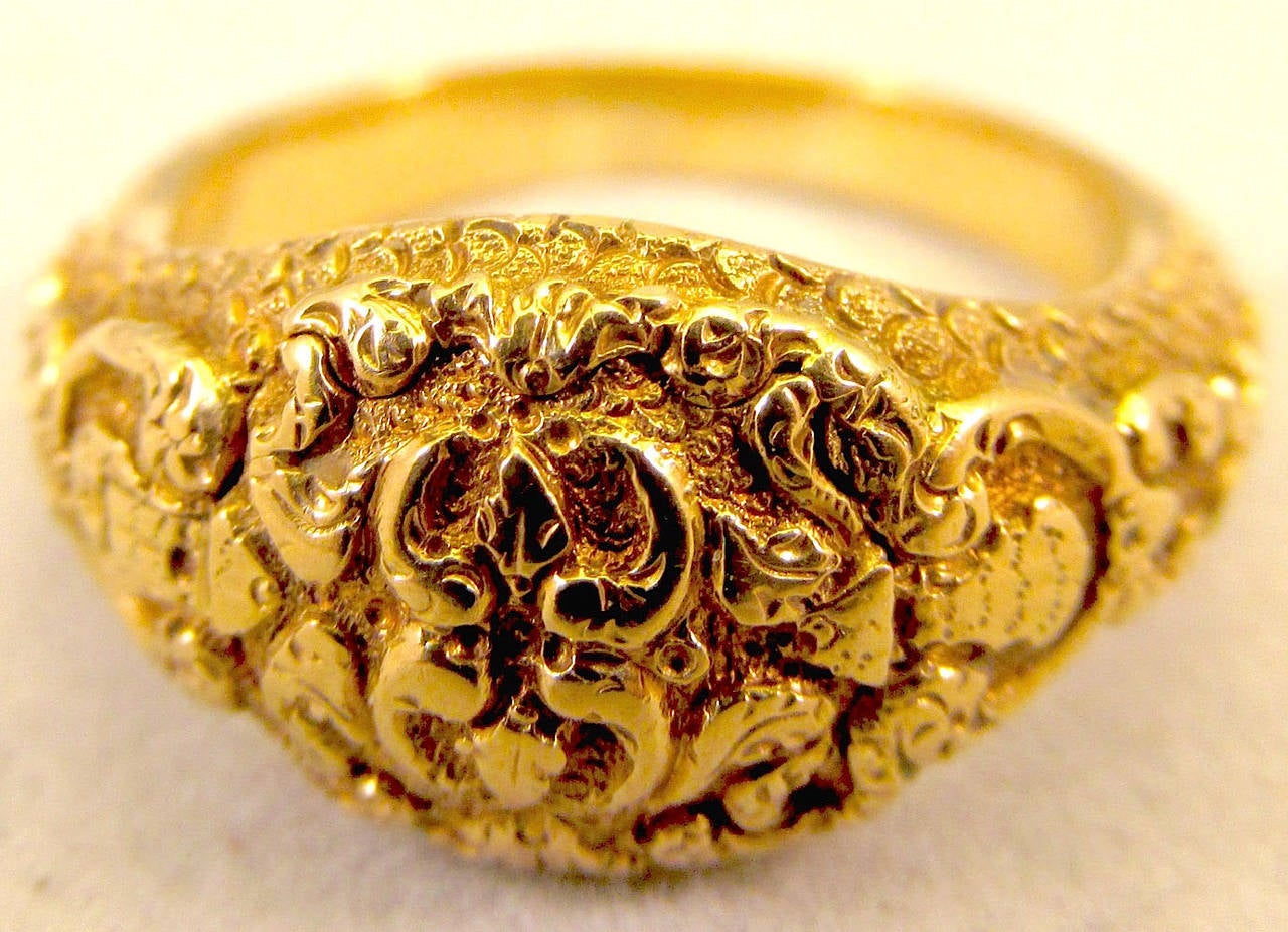 Lovely ornately chased 18K gold Georgian memorial ring dedicated to Queen Caroline of Brunswick. She was married to the future George the IV who was already married illegally to Maria Fitzherbert. Nine months after the wedding Caroline had a child,