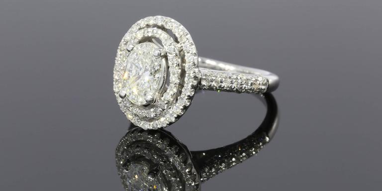 Stunning Oval Brilliant Diamond Double Halo Engagement Ring For Sale