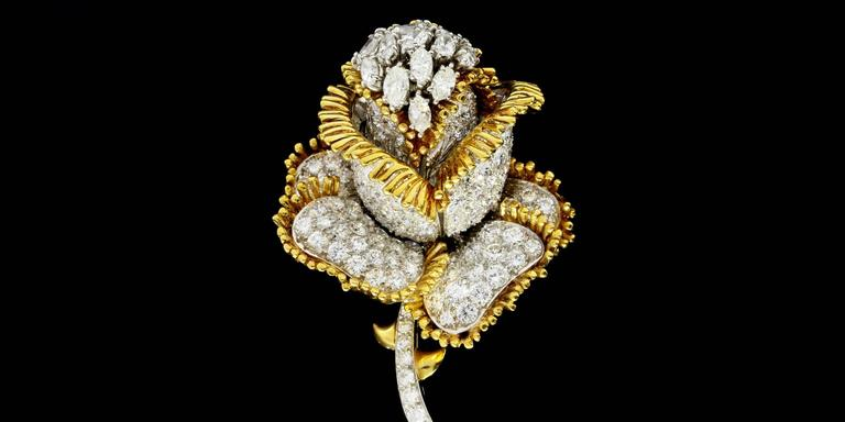 Your look will get a sparkly touch with this beautiful, one of a kind diamond pin/brooch! It features 205 marquise & round brilliant cut diamonds that have a combined total weight of 11 carats! The diamonds are GH/SI in quality. The marquise