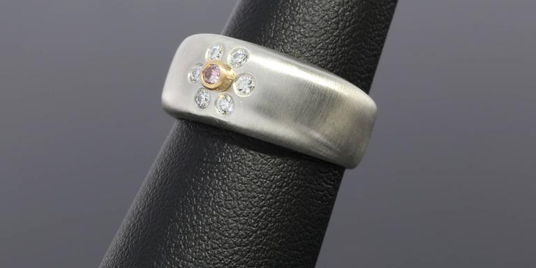 This unique band is a beautiful platinum & 18 karat rose gold diamond band from Suna